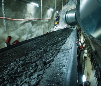 Excavated masses are transported by a conveyor belt along the 150m long TBM.